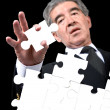 Business man solving a puzzle - Photo