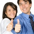 Business partners with thumbs up - Stock Photo