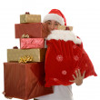 Lots of christmas gifts by santa — Stock Photo