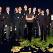 Business team on top of the world - Stock Photo