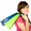 Stock Photo: Beautiful teenager with shopping bags