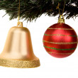 Christmas ball and bell on a xmas tree - Zdjęcie stockowe