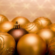 Golden christmas baubles — ストック写真