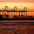Cargo ship at sunset — Stock Photo