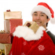 Santa claus full of gifts — Stock Photo #7748894