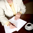 Business woman doing paperwork — Stock Photo