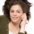 Beautiful girl talking on the phone - Stock Photo