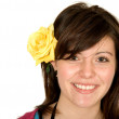 Beautiful teenager girl with a yellow rose — Stock Photo