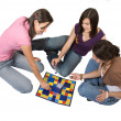 Stock Photo: Friends playing board games