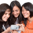 Girls sharing their photos — Stock Photo