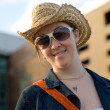 Stockfoto: Female wearing a hat and sunglasses outdoors