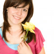 Stock Photo: Beautiful girl with flower