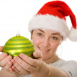 Beautiful santa holding a christmas bauble - Stock Photo