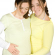 Pregnant woman and her sister — Stockfoto