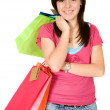 Beautiful teenager with shopping bags — Стоковая фотография