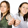 sisters holding lightbulbs — Stock Photo