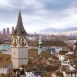 Zurich skyline with tower clock - Stok fotoğraf
