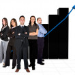 Business team in front of a graph - Stock Photo