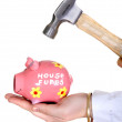 Foto Stock: Break piggy bank