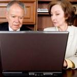 Business senior couple on a laptop — Stock Photo