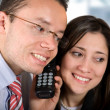 Stock Photo: Business partners - good news on the phone