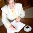 Business woman writing a letter — Stock Photo