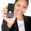 Asian business woman showing mobile phone — Stock Photo