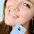 Business woman with credit card — Stock Photo