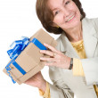 Business woman happy with gift — Stock Photo