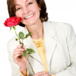 Business Woman holding a red rose — Stok fotoğraf