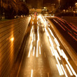Stock Photo: Moving traffic at night