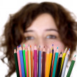 Beautiful girl holding color pencils — Stock Photo