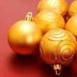 Christmas golden baubles - Stock Photo