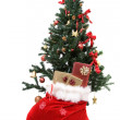 Christmas tree with gifts on sack — Stok fotoğraf