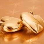 Couple of golden hearts — Stock Photo