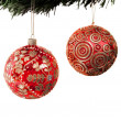 Christmas balls hanging from a xmas tree — Stok fotoğraf