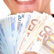 Euro notes with big smile — Stock Photo