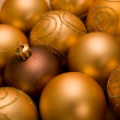 Golden christmas baubles - Stock Photo