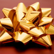 Stock Photo: Golden gift ribbon