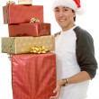 Casual santa claus with gifts - Stock Photo