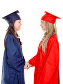 Graduates handshaking — Stock Photo