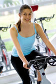 Woman doing spinning at the gym — Stock Photo