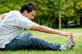 Man doing stretching exercises — Foto Stock