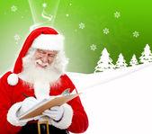 Santa schrijven van een lijst — Stockfoto