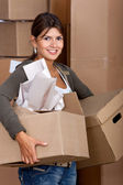 Woman moving in — Stock Photo