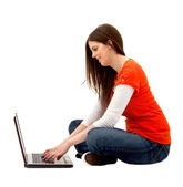Casual woman on a laptop — Stock Photo