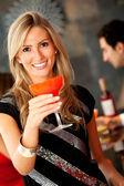 Woman with a cocktail — Stock Photo