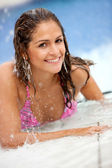 Woman at the swimming pool — Stock Photo