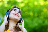 Woman with earphones outdoors — Stock Photo