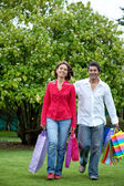 Happy couple with bags — Stock Photo